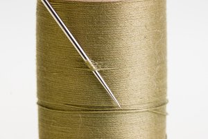 Green thread with needle