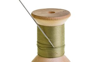 Spool of green thread isolated