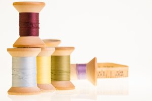 Spools of thread with tape