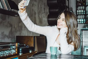 happy brunette girl doing selfie