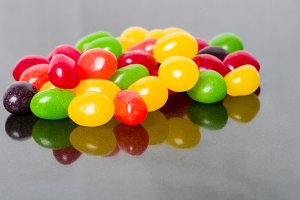 Jelly beans on glossy surface