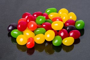 Jelly beans on black surface