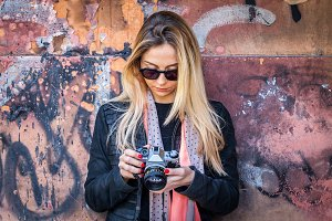 Hipster girl with vintage camera