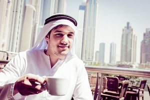 Young Arabian Man Having Coffee
