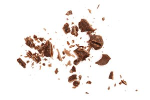 grated chocolate isolated on white background. Top view