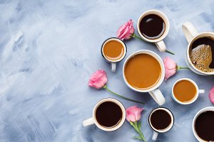 Cups and mugs of coffee and flowers