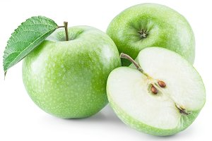 Ripe green apples on the white