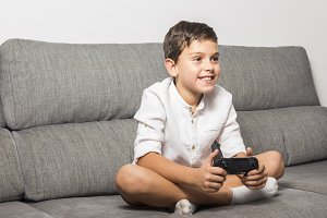 Boy playing at video game