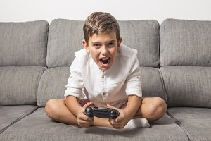 Boy playing at video game