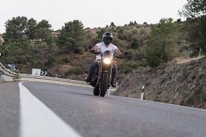 Man riding bicycle on mountain road