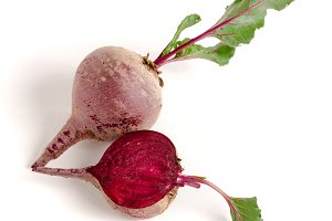 beetroot and half with leaf isolated on white background