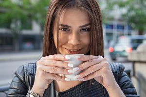Woman having coffee on terrace