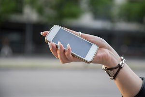 Hand of a girl holding a smart phone