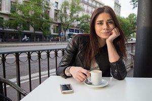 Girl drinking coffee in the street
