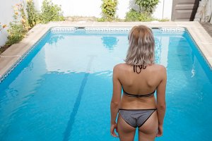 Woman standing at pool