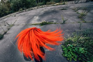 Redhead girl is turned on round asphalt sqare. Circular effect.