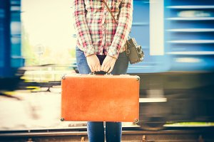 Girl with suitcase on platform