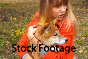 Girl and Shiba Inu outdoors
