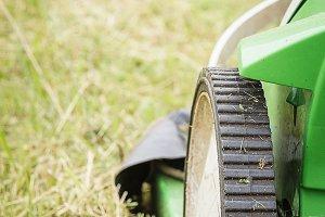 Closeup of lawnmower in the garden