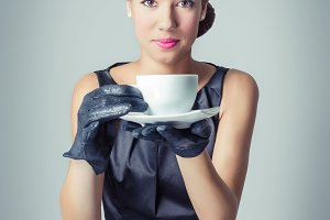 Fashion young girl with a coffee cup