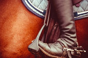 Jockey riding boot, saddle, stirrup