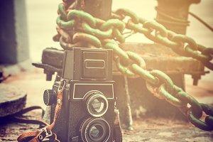 Vintage camera near mooring bollard