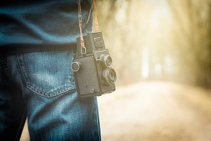 Photographer with retro camera