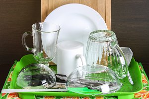 Pure dishes are dried. A glass, a mug, a board, a plate, cutlery.
