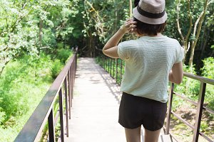 Thai woman walking on the bridge