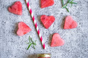 Watermelon juice in a bottle And pieces of watermelon in the form of heart