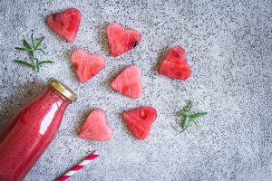Watermelon rosemary smoothies in a bottle And pieces of watermelon in the form of heart