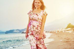 Pretty woman in dress on the beach