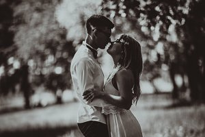 Black and white photo Young beautiful couple on a blurred natural background