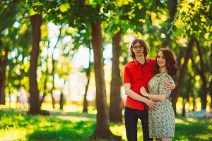 Beautiful young couple on the park background