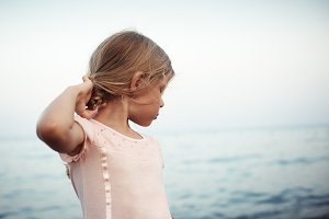 Cute little girl at the sea