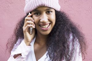 afro girl talking with mobile phone