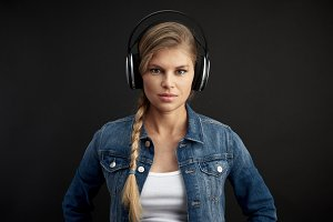 Female dj in earphones