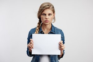 Young woman holding white sheet