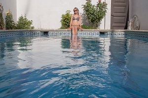 Fit woman posing in pool