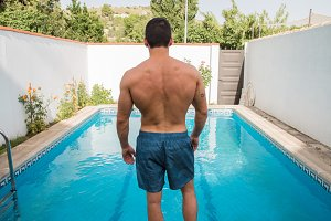 Back of muscular man in the pool