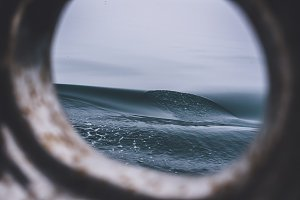 Porthole on Ship and Dark Waves