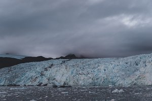 Dark Clouds and Glacier Ice