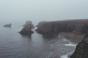 Cliffs and Waves in the Fog