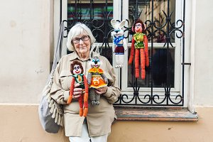Senior lady selling knitted toys