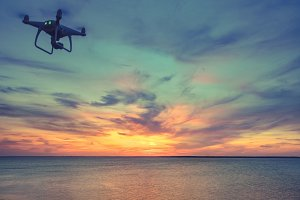 Drone in sunset sky