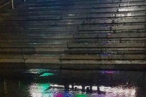 City, night, rain.  (vertical frame)