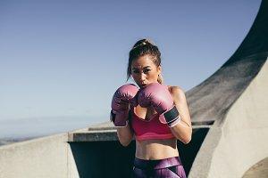 Fit woman boxer combat stance