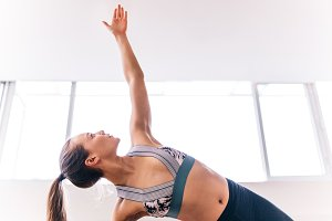 Fit woman doing the side plank