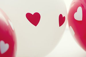 Balloons with hearts.
