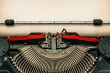 Antique typewriter with aged paper